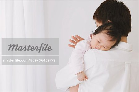Baby boy sleeping on his fathers shoulder Stock Photo - Rights-Managed, Image code: 859-06469772