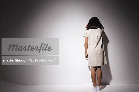 Girl in a white dress crying against a wall Stock Photo - Rights-Managed, Image code: 859-06537707