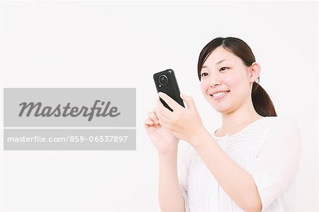 Woman using Smartphone Stock Photo - Rights-Managed, Image code: 859-06537897