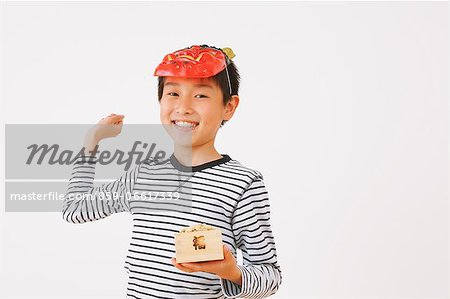 Boy Throwing Beans For the Traditional End Of Winter Stock Photo - Rights-Managed, Image code: 859-06617339