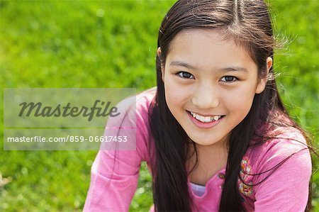 Girl Relaxing On the Grass Stock Photo - Rights-Managed, Image code: 859-06617453