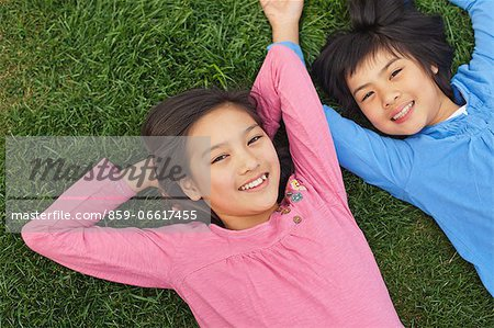 Girl And Boy Relaxing On the Grass Stock Photo - Rights-Managed, Image code: 859-06617455