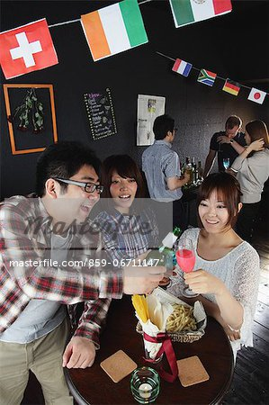 Young people having a drink in a bar Stock Photo - Rights-Managed, Image code: 859-06711147