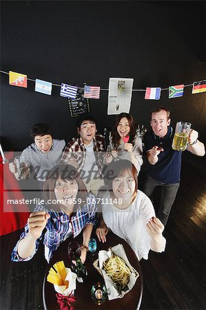 Young people cheering in a bar Stock Photo - Rights-Managed, Image code: 859-06711148