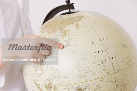 Child pointing a finger on globe Stock Photo - Rights-Managed, Image code: 859-06808669