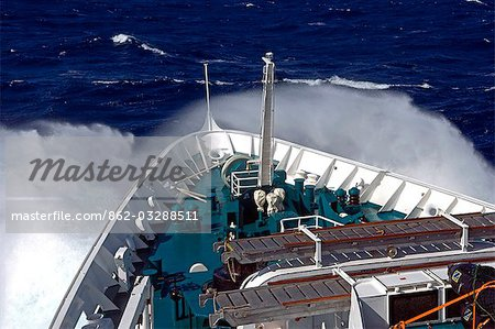 Antarctica,Antarctic Peninsula,Drakes Passage. Running into heavy seas,the bow of the expedition ship MV Discovery cut a path through the deep blue sea separating the southern continent from South America. Stock Photo - Rights-Managed, Image code: 862-03288511