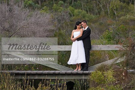 A couple in formal dress in the bush settings of the Kingfisher Bay Resort on Fraser Island. Stock Photo - Rights-Managed, Image code: 862-03288755