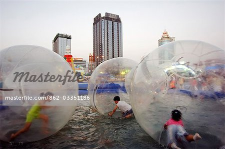 China,Shandong Province,Qingdao City. Amusement park at the Qingdao International Beer Festival. Qingdao is the host of the sailing events of the 2008 Olympic Games. Stock Photo - Rights-Managed, Image code: 862-03351186