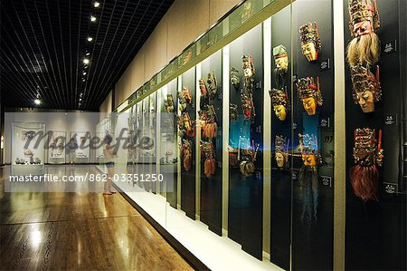 China,Shanghai,Shanghai Museum. Chinese Minority Nationalities Art Gallery - colour lacquered wooden masks for Di Xi. Stock Photo - Rights-Managed, Image code: 862-03351250