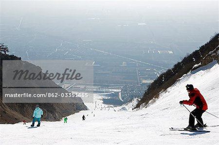 China,Beijing,Shijinglong ski resort. Skiers on the mountain. Stock Photo - Rights-Managed, Image code: 862-03351465