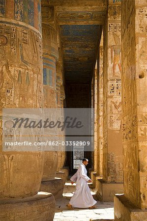 The colours of the original painting dating from the New Kingdom can still be seen on the columns of Ramses III's mortuary temple at Medinet Habu on the West Bank,Luxor,Egypt Stock Photo - Rights-Managed, Image code: 862-03352909