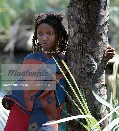 A young Afar girl at Filwoha in the Awash National Park. Filwoha in the Afar language means 'hot water'. The beautiful springs are surrounded by doum palms and rise from deep underground at about 96.8 degrees F. Stock Photo - Rights-Managed, Image code: 862-03353976