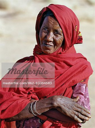 Nubian women wear bright dresses and headscarves even though they are Muslims. Many of the older generation have tribal scars on their faces.