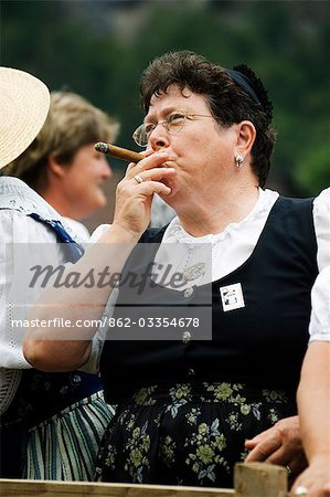 A woman smoking a cigar at the Unspunnen Festival Bicentenary,Interlaken,Jungfrau Region,Switzerland Stock Photo - Rights-Managed, Image code: 862-03354678