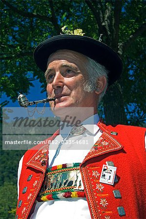 A Swiss man smoking a pipe in traditional alpine costume at the Unspunnen Bicentenary Festival,Interlaken,Jungfrau Region,Switzerland Stock Photo - Rights-Managed, Image code: 862-03354681