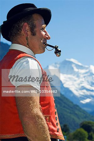 A Swiss man smoking a pipe in traditional alpine costume at the Unspunnen Bicentenary Festival,Interlaken,Jungfrau Region,Switzerland Stock Photo - Rights-Managed, Image code: 862-03354682
