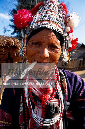 Woman from hilltribe smoking Opium in the Golden Triangle,Thailand Stock Photo - Rights-Managed, Image code: 862-03354985