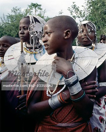 Maasai girls gather to celebrate a wedding. Their broad beaded necklaces with predominantly white glass beads mark then as Kisongo Maasai,the largest clan group of the tribe which lives either side of the Kenya-Tanzania border. Stock Photo - Rights-Managed, Image code: 862-03355142