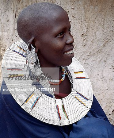 A Maasai woman wearing a very fine beaded necklace. The predominant white colour of her glass beadwork marks her as a Kisingo Maasai,the largest clan group of her tribe living either side of the Kenya-Tanzania border. Stock Photo - Rights-Managed, Image code: 862-03355143