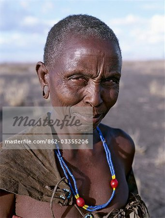 An old Datoga woman. Her traditional attire includes a beautifully tanned and decorated leather dress . The Datoga (known to their Maasai neighbours as the Mang'ati and to the Iraqw as Babaraig) live in northern Tanzania and are primarily pastoralists. Stock Photo - Rights-Managed, Image code: 862-03355206