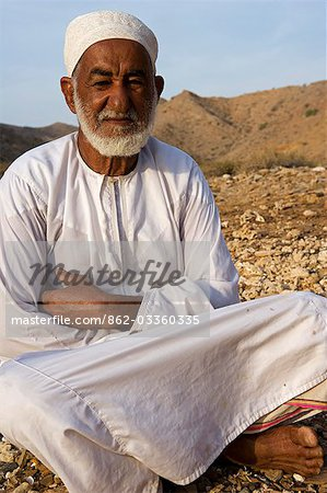 Oman,Muscat Region,Bandar Khayran. A old farmer sits down for a chat dressed in traditional Omani clothing. Stock Photo - Rights-Managed, Image code: 862-03360335