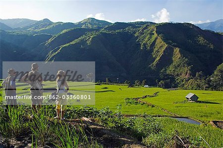 Philippines,Luzon Island,The Cordillera Mountains,Kalinga Province,Tinglayan. Western tourists and guide looking at rice terraces in Luplula village. Stock Photo - Rights-Managed, Image code: 862-03360801