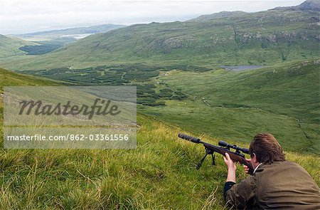 Getting ready to take a shot at a red deer stag on Benmore Estate Stock Photo - Rights-Managed, Image code: 862-03361556