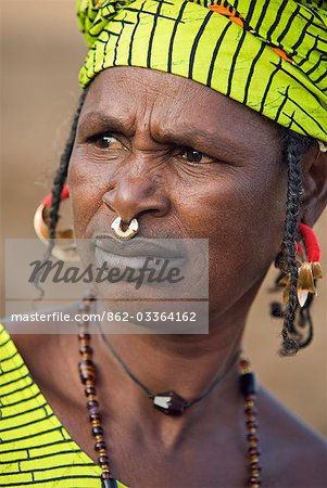 Mali,Douentza. A Bella woman wearing gold jewellery in her village near Douentza. The Bella are predominantly pastoral people and were once the slaves of the Tuareg of Northern Mali. Stock Photo - Rights-Managed, Image code: 862-03364162