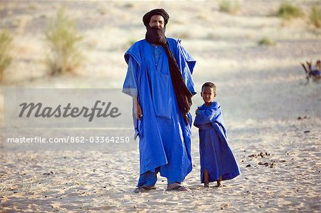 Mali,Timbuktu. A Tuareg man and his son in the desert north of Timbuktu. Stock Photo - Rights-Managed, Image code: 862-03364250