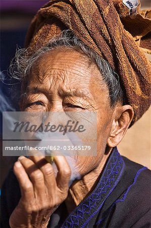 Myanmar,Burma,Lake Inle. An old Pa-O woman smokes a cheroot. Stock Photo - Rights-Managed, Image code: 862-03365179