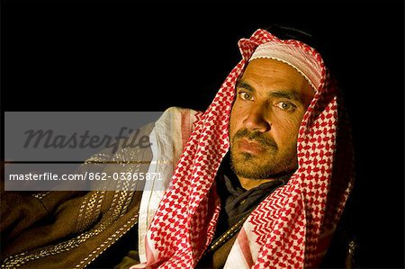 Jordan,Petra Region. A Beduin man relaxing in the evening by the campfire Stock Photo - Rights-Managed, Image code: 862-03365871