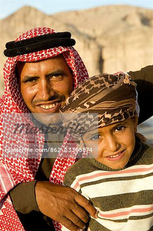 Jordan,Finan. Beduin family smile and pose for the camera. Stock Photo - Rights-Managed, Image code: 862-03365874