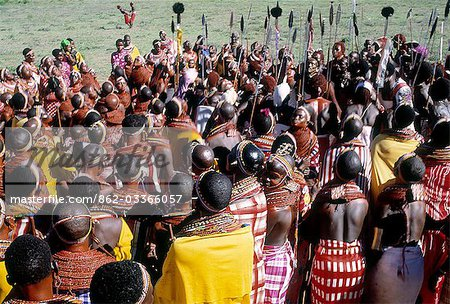 The invited guests at a Samburu wedding gather together to sing in praise of the couple and to dance. Celebrations will go on late into the night. Stock Photo - Rights-Managed, Image code: 862-03366057