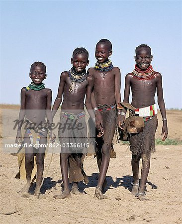 A jovial group of Turkana girls in traditional attire. Their aprons are made of goatskin,either beaded or cut into thin strips before braiding. The two girls in the middle have already had the flesh below their lower lips pierced in readiness for a brass ornament after marriage. Stock Photo - Rights-Managed, Image code: 862-03366115