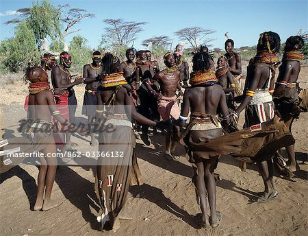 Song is an art form ingrained in Turkana culture. At the end of a dance session,the participants invariably enjoy the Song of the Bulls. Each young man will take centre-stage to extol the praises of his favourite ox. He will explain how it came into his possession,its distinguishing traits and with outstretched arms,imitate the shape of its horns. Stock Photo - Rights-Managed, Image code: 862-03366132