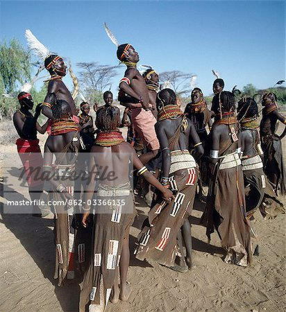 Song is an art form ingrained in Turkana culture. At the end of a dance session,the participants invariably enjoy the Song of the Bulls. Each young man will take centre-stage to extol the praises of his favourite ox. He will explain how it came into his possession,its distinguishing traits and with outstretched arms,imitate the shape of its horns. Stock Photo - Rights-Managed, Image code: 862-03366135