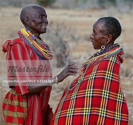 Two Maasai women in traditional attire chat to each other. Stock Photo - Rights-Managed, Image code: 862-03366169