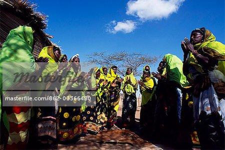 Gabbra women dance at a gathering in the village of Kalacha. The Gabbra are a Cushitic tribe of nomadic pastoralists living with their herds of camels and goats around the fringe of the Chalbi Desert. Stock Photo - Rights-Managed, Image code: 862-03366480