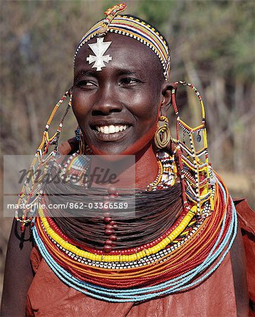 A Samburu woman wearing a mporro necklace,which signifies her married status.These necklaces,once made of hair from giraffe tails,are now made from fibres of doum palm fronds (Hyphaene coriacea). The beads are mid-19th century Venetian glass beads,which were introduced to Samburuland by early hunters and traders. Stock Photo - Rights-Managed, Image code: 862-03366589