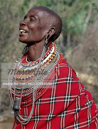 A Samburu woman singing. The strings of black and white beads hanging from her ears signify that she has two grown-up sons who are warriors of the tribe. Note: the traditional horn snuff container hanging from her neck. Stock Photo - Rights-Managed, Image code: 862-03366590