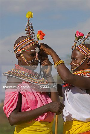 Two young Samburu girls help each other preparing for a celebration,Wamba District,Kenya Stock Photo - Rights-Managed, Image code: 862-03366627