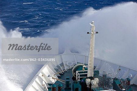 Antarctica,Antarctic Peninsula,Drakes Passage. Running into heavy seas,the bow of the expedition ship MV Discovery cut a path through the deep blue sea separating the southern continent from South America. Stock Photo - Rights-Managed, Image code: 862-03436895