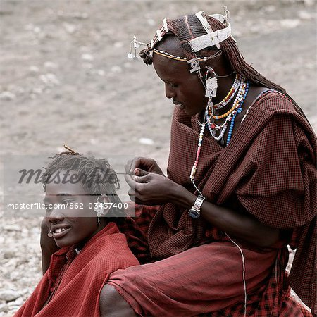 Maasai warriors take enormous trouble over their appearance especially their long hair,which is braided,Ochred and decorated with beaded ornaments. This singular hairstyle sets them apart from the rest of their community. Stock Photo - Rights-Managed, Image code: 862-03437400