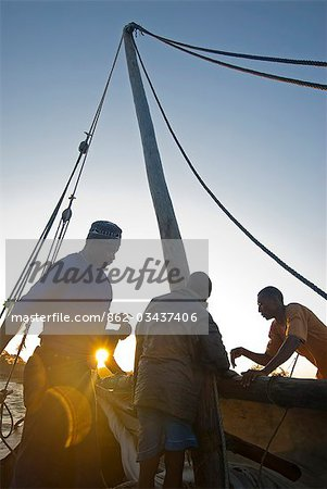 East Africa,Tanzania. Sailing an Arab dhow in Zanzibar. A dhow is a traditional Arab sailing vessel with one or more lateen sails. It is primarily used along the coasts of the Arabian Peninsula,India,and East Africa. Stock Photo - Rights-Managed, Image code: 862-03437406