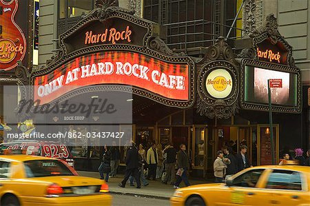 New York City cabs pass in front of the Hard Rock Cafe at Times Square Stock Photo - Rights-Managed, Image code: 862-03437427