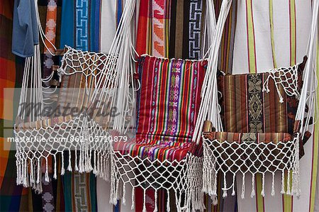 Ecuador, Market stalls selling brightly-coloured, locally-made hanging chairs at Otavalo. Stock Photo - Rights-Managed, Image code: 862-03710879