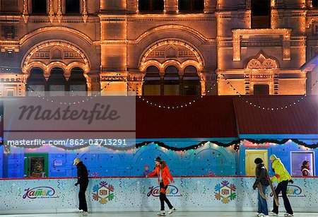 Russia, Moscow; Youths ice-skating in front of the huge Shopping Mall, the Gum, on Red Square in winter Stock Photo - Rights-Managed, Image code: 862-03713291