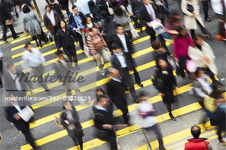 Office workers crossing Queen's Road Central, Hong Kong, China Stock Photo - Rights-Managed, Image code: 862-03731029