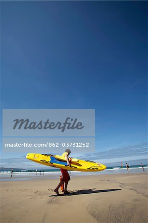 England; Cornwall. Beach lifeguard on Gwithian Sands, near Hayle. Stock Photo - Rights-Managed, Image code: 862-03731252