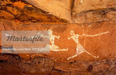 Libya, Fezzan, Jebel Akakus. A pair of running figures painted onto the walls of Uan Muhuggiag, one of Wadi Teshuinat's caves. Stock Photo - Rights-Managed, Image code: 862-03731755